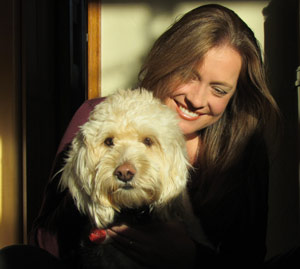 Designer and Doodle: Laura with her office dog, Cali. Laura's background in business is important.